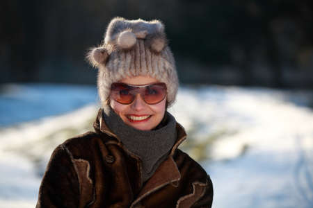 bobble: Beautiful woman with a bobble hat and sunglasses Stock Photo