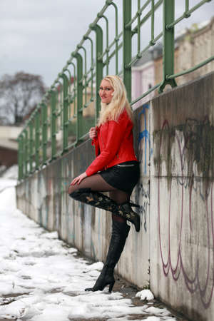 leather woman: Beautiful blonde woman in red leather jacket and mini skirt