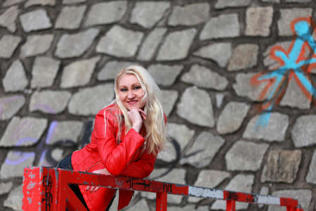 red leather: Beautiful blonde woman in red leather jacket Stock Photo