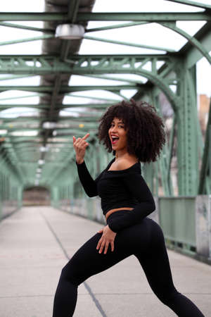 obscene: Beautiful African girl with curly hair with obscene pose