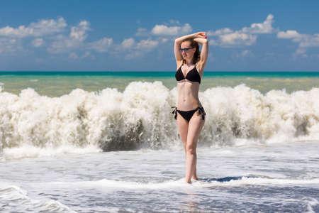 woman bath: Pretty bikini girl at the coast of Black Sea