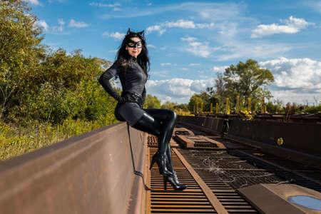 Woman in Catwoman costume on railroad waggon