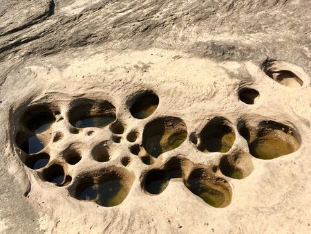 Characteristic hole of stone texture on reef coast Stock fotó
