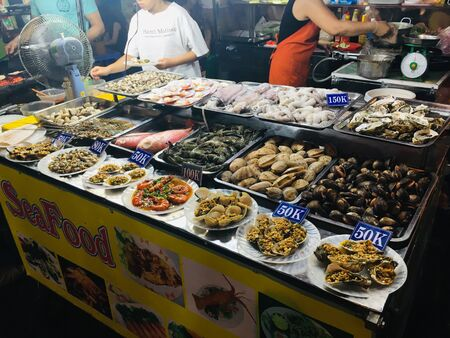 Many kind of seafood, enjoy side way local street food style in Danang city, Vietnam