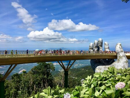 The Golden Bridge is lifted by two giant hands on Ba Na Hills mountain resort in Danang, Vietnam Editorial