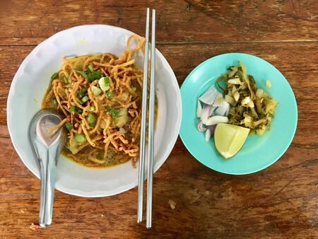 Curry noodle soup with chicken (Khao Soi), North of Thailand popular local food, top view 版權商用圖片