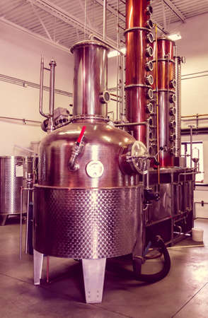 microbrewery: A microbrewery distillery still used to make vodka and whiskey, with vintage effect