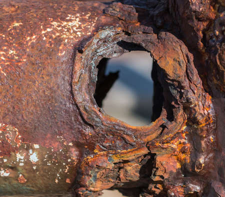 crack pipe: Rusted through metal pipe with a visible hole Stock Photo