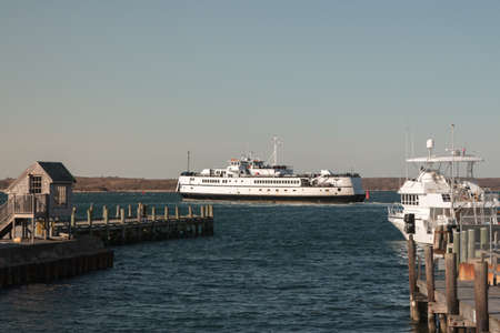 cod hole: Woods Hole, MassachusettsUSA - April 5, 2015: Ferry leaving Woods Hole for Marthas Vineyard Editorial