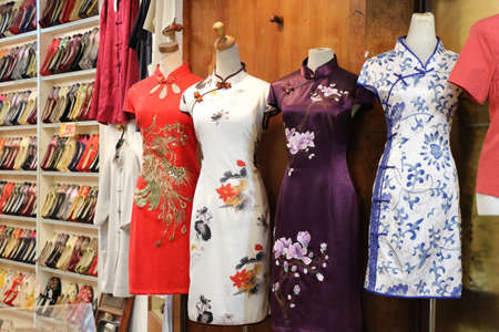 Chinese traditional dress store with cheongsam. Фото со стока