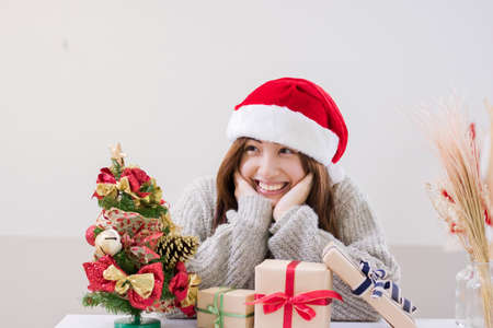 Smiling young woman and Christmas present box.