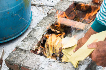 Chinese traditional religion activity - burning some paper money for the Gods Stock Photo