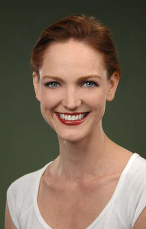 redheaded: Portrait of Redheaded woman smiling Stock Photo