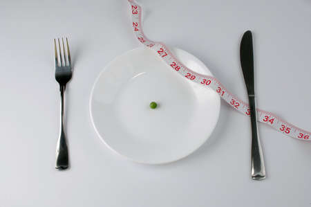 starvation: Extreme diet with pea and tape measure