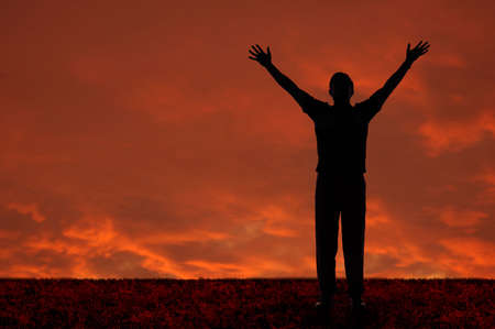 Man with arms extended toward heaven Stock Photo