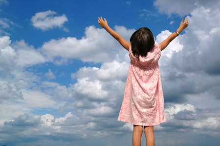 Girl with arms raised toward heaven