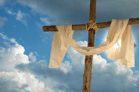 Cross and cloth against backlit blue sky photo