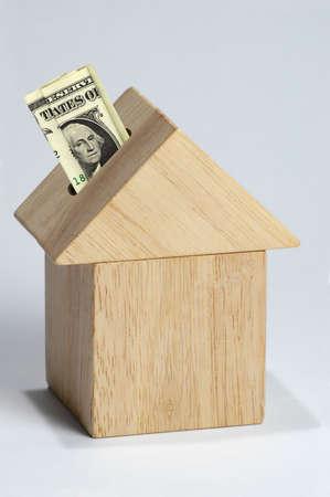 �quit�: Accueil comme un investissement repr�sent� par l'argent et la maison