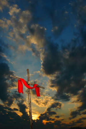 redemption of the world: Cross with cloth over sunset Stock Photo