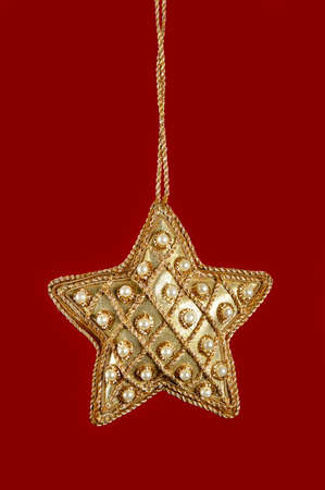 Christmas Star With Pearls and Gold on a red background Stock Photo