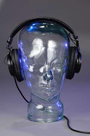 Headphones over glass head