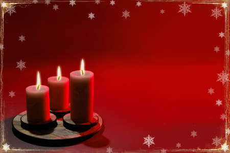 Christmas background with candles and snowflakes over red background. photo