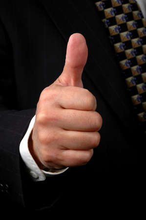 Hand of businessman showing the thumbs up symbol Stock Photo - 542303