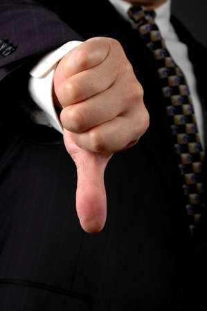 negation: Hand of businessman showing the Hands Down symbol.
