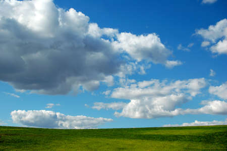 Blue sky with clouds and grass as foreground photo