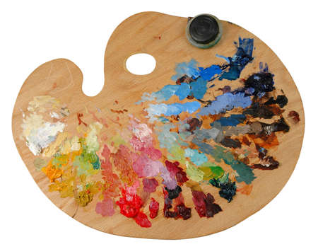 Artists palette with oil colors and solvent container photo