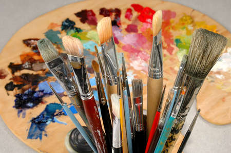 Close-up of artists brushes with palette in the background. photo