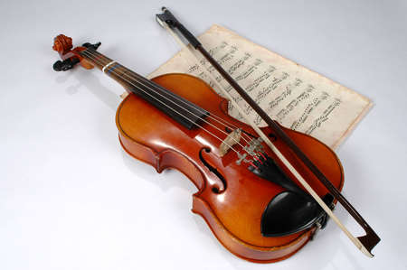 Old violin with vintage music sheet photo