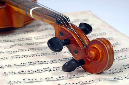 Violin Scroll With Vintage Music Sheet