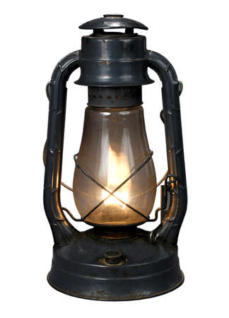 Lit Antique oil lamp with clipping path photo