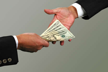 Money exchange between two businessmen (with Clipping Path) photo