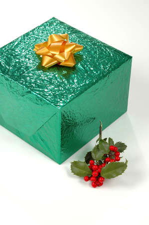 Gift Box with holly over a white background Stock Photo - 624992