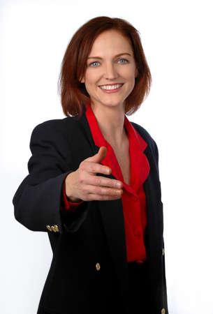 Businesswoman extending hand to handshake.