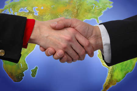 Uniting the world through global interaction (With Clipping Path on the handshake) Stock Photo
