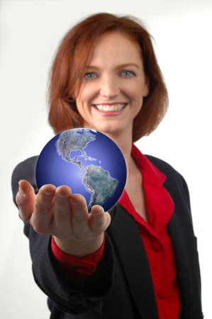 Businesswoman holding the Earth in her hand. Stock Photo - 650720
