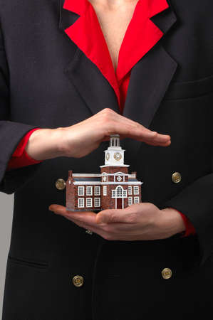 Woman holding Commercial Building representing the Real Estate business. photo