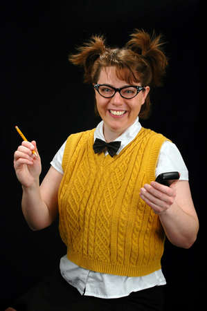 Nerd girl with calculator and pencil smiling photo