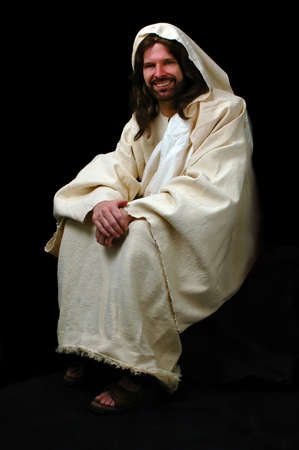 Jesus sitting and smiling over a black background