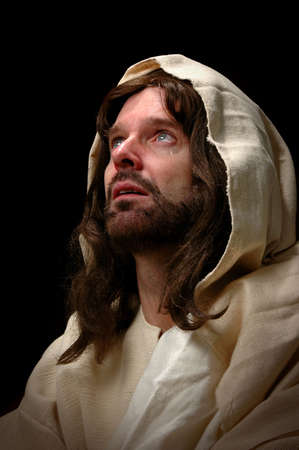 Jesus cried. Represented by portrait of Jesus looking into heaven and shedding a tear. photo
