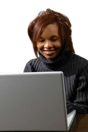 Attractive businesswoman with laptop computer over white background