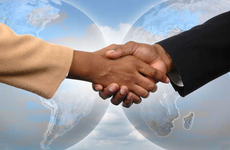 Global agreement depicted by handshake between man and woman