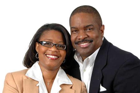 La pareja sonriente vestido con traje formal aislado en un fondo blanco  Foto de archivo - 897735