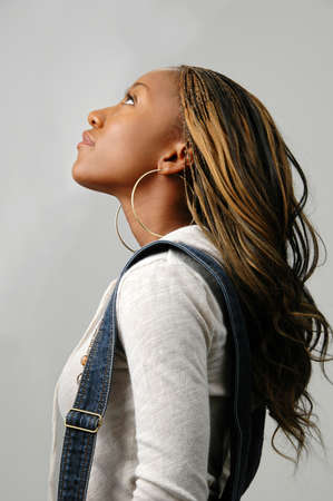 Beautiful African American woman looking up to heaven Stock Photo