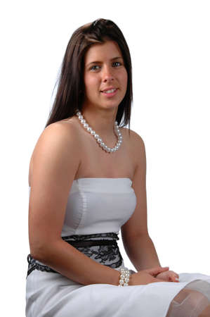 sitted: Teenager with prom dess sitted isolated over a white background