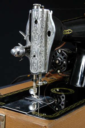 Detail of vintage sewing machine over a dark background 写真素材