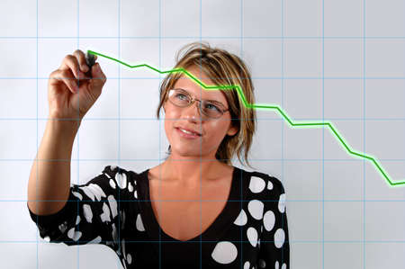 charting: Attractive Young woman with electronic pen charting growth. Stock Photo